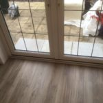 Wood vinyl tile fitted up to garden doors