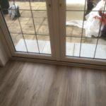 Wood vinyl tile fitted up to garden doors