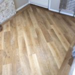 Wood effect plank flooring in bathroom