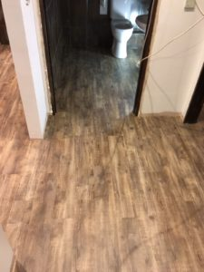 Rustic wood effect vinyl tile flooring