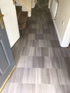 Amico Spacia abstract grey flooring in corridor entrance hallway