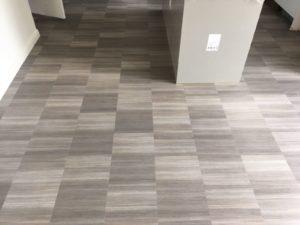Amico Spacia abstract grey flooring in corridor entrance hallway