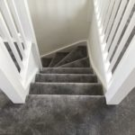 Dark grey soft feel silk carpet down the stairs & landing