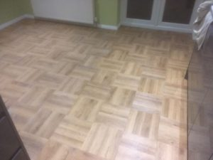 Wood effect luxury vinyl tile basket weave