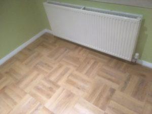 Wood effect luxury vinyl tile basket weave