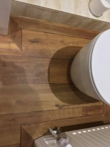 Dark/mid oak wood effect ship deck vinyl tile