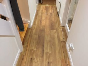 Dark/mid oak wood effect ship deck vinyl tile body and border