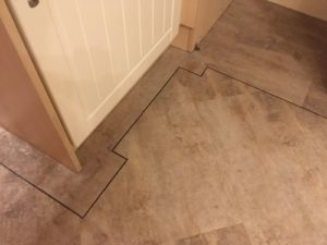 Distinctive vinyl tile with tramline border