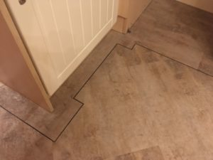 Distinctive vinyl tile with tramline border