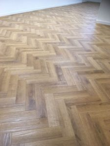 mid light oak wood effect flooring laid parquet style