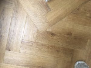 Close up photo of a wood effect parquet border