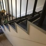 commercial stairs with new nosings and trims and blue safety flooring