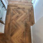 Vusta mid oak warm deep wood effect parquet laid herringbone with a border