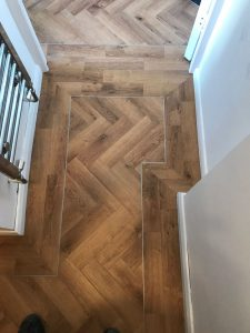 Vusta mid oak warm deep wood effect parquet laid herringbone with a border