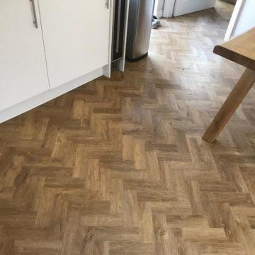 Amtico Form flooring colour Rural Oak Parquet laid herringbone